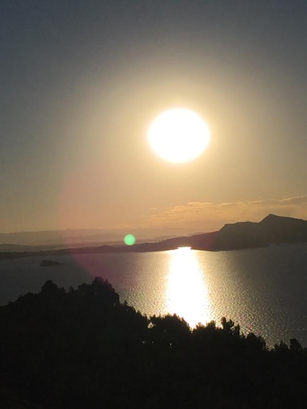 Sun over lake Titicaca | Sacred Center Journey to Peru
